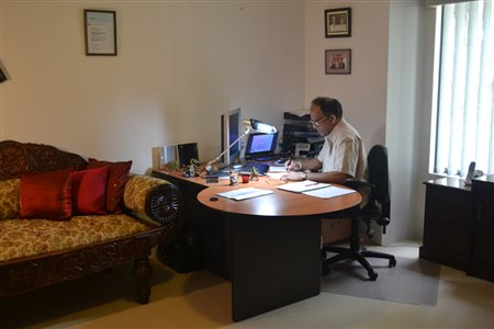 Dr Theja at his office in Atwell, Perth, Australia